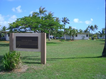 navy-base-housing-with-gravesite-sign-guam-jun-06.JPG