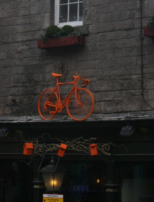 Orange Bike in Ediburgh ~ nice color for a grey day