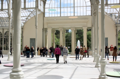Inside the Palacio de Cristal ~ dics on the floor are part of the modern art exhibition