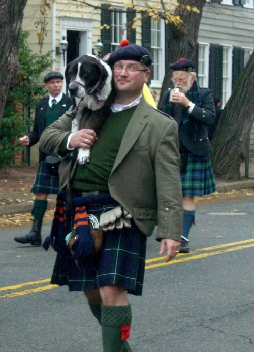Men in Kilts with Dogs